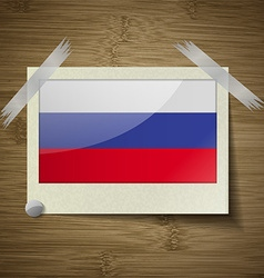 Flags russia at frame on wooden texture vector