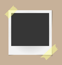 Realistic photo frame on sticky tape on beige vector