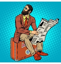 Bearded hipster traveler reading a newspaper vector
