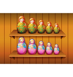 Dolls arranged in the wooden shelves vector