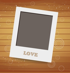 Blank instant photo on wood background vector