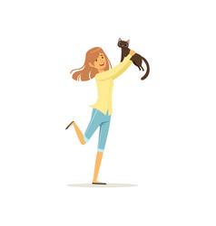 Cute brunette girl holding brown cat in hands vector