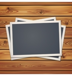 Realistic vintage photo frames on planks vector image
