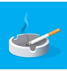 Ashtray with lighted cigarette on blue background vector
