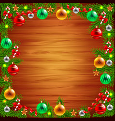 Christmas tree branches around the wood background vector