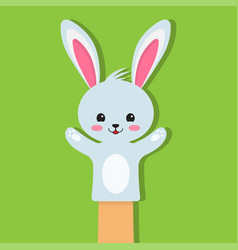 Rabbit puppet on a green background vector