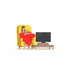 Young woman sitting on armchair with red blanket vector