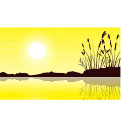 Silhouette of coarse grass with yellow sky vector