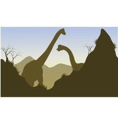 Silhouette of brachiosaurus behind the cliff vector