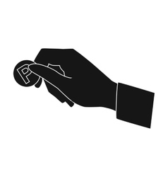 Hand holding coin for parking meter icon in black vector