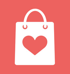 shopping bag with shape of the heart icon vector image