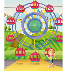 A girl below the ferris wheel vector