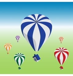 Hot air balloons flying with house vector