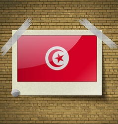 Flags tunisiaat frame on a brick background vector