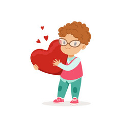 cute little boy in glasses holding red heart vector image vector image