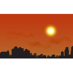 Silhouette of the city at sunset vector image
