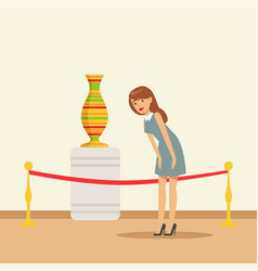Young woman viewing antique vase at the museum vector