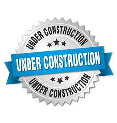 Under construction 3d silver badge with blue vector