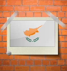 Flags cyprus scotch taped to a red brick wall vector