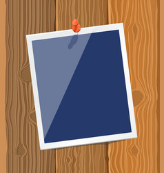 Photo frame on wood texture vector