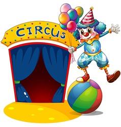 A clown with balloons balancing above a ball vector image