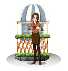 A girl in front of the coffeehouse vector image