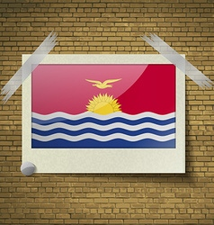Flags kiribati at frame on a brick background vector