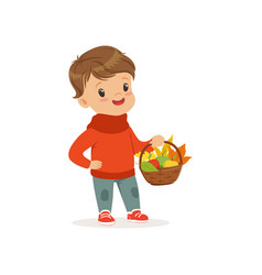 Cute little boy in warm clothing holding basket vector