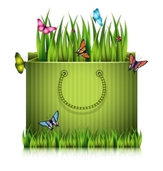 Paper shopping bag with fragment of grass vector