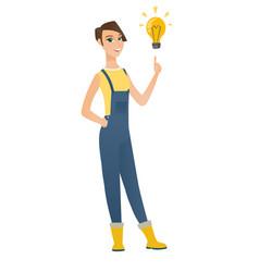 Farmer pointing at bright idea light bulb vector