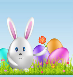 Easter bunny and colorful eggs on spring medow vector