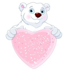 Polar bear holding heart shape sign vector