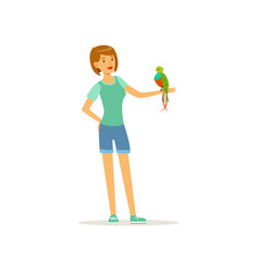 woman holding tropical bird with colored feathers vector image