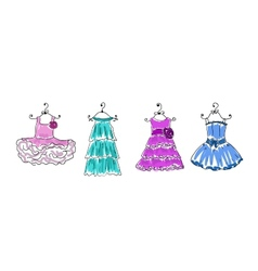 Four dresses of different coloring on hangers vector