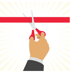 hand cutting a red ribbon vector image vector image