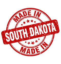 Made in south dakota red grunge round stamp vector