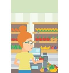Cashier at supermarket checkout vector