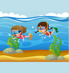 two kids diving under the ocean vector image vector image