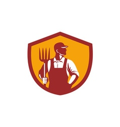 Organic farmer pitchfork crest retro vector