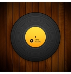 Black vintage vinyl record isolated on red wood vector image