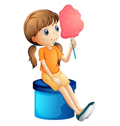 A young woman eating a cotton candy vector