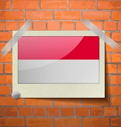 Flags indonesia scotch taped to a red brick wall vector