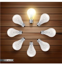 Glowing bulb on wooden background vector image