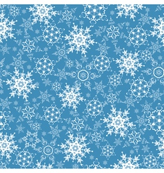 Festive seamless pattern with ornate snowflakes vector