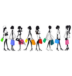 Set of silhouettes of girls women with shopping vector