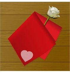Teat towel folded on a rose on wood background vector