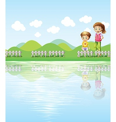 A boy and a girl watching the lake vector image vector image