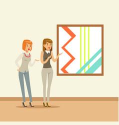 Two women standing in modern art gallery in front vector