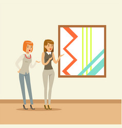 Two women standing in modern art gallery in front vector