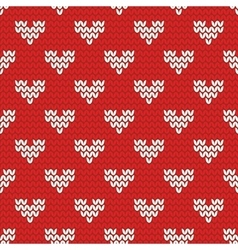 Tile knitting pattern with white hearts on red vector